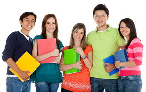 Group of students holding notebooks